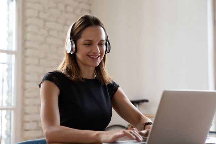 Woman Wearing Headphones Working Typing On Notebook Enjoy E Learning Process