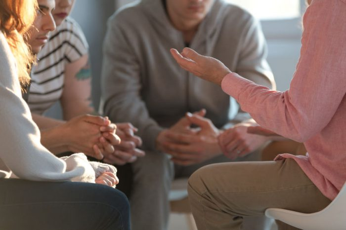 Close Up Of A Therapist Gesticulating While Talking To A Group O
