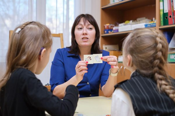 Speech Therapist Holds A Lesson With Young Children